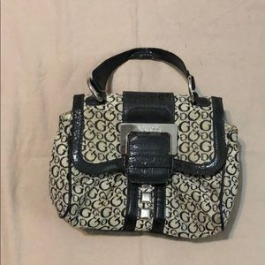Black and Tan Guess purse with magnetic closure